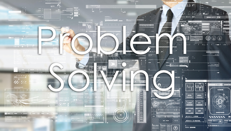 the businessman in the office is writing on the transparent board: Problem Solving 版權商用圖片 - 75830191