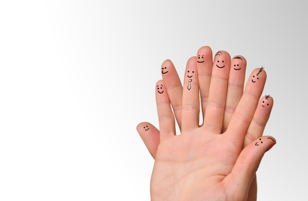 Happy group of finger smileys. Fingers representing a social network.