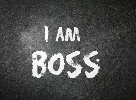 I am BOSS handwritten with white chalk on a blackboard