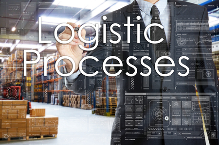 the businessman is writing things connected with the logistics in warehouse. Logistic Processes