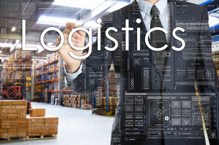 the businessman is writing things connected with the logistics in warehouse. Logistics 版權商用圖片 - 75830222
