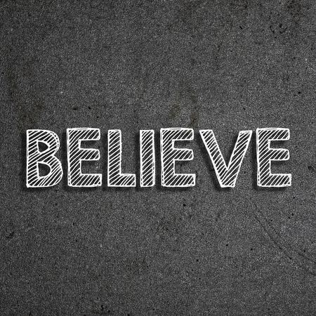 Believe written on a chalkboard 版權商用圖片