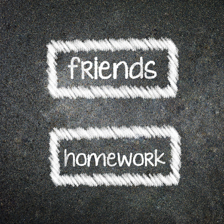 friends and homework of your choice written with white chalk on a blackboard 版權商用圖片