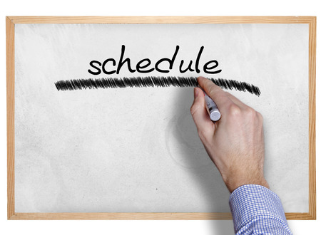Hand writing schedule on board