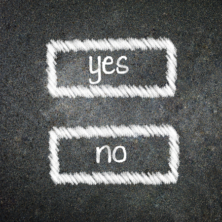 Yes or no written on the blackboard with white chalk. Your choice as a concept.