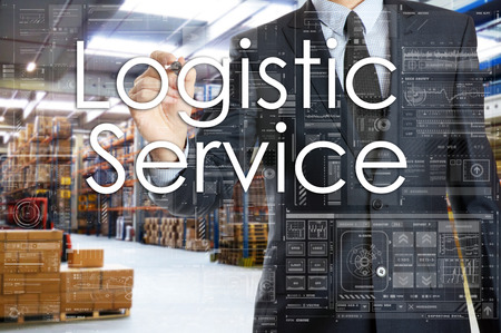 the businessman is writing things connected with the logistics in warehouse. Logistic Service Stock Photo
