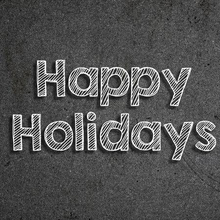Happy holidays written on a chalkboard 版權商用圖片