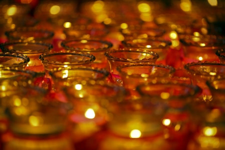 gladden: burning candle in the glass  Stock Photo