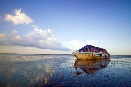 The low tide boat abandoned Stock Photo - 17187551