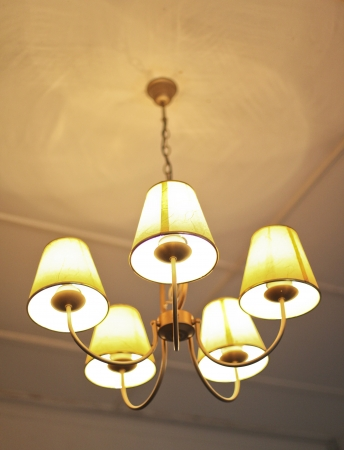beatiful chandelier light hanging on the ceiling photo