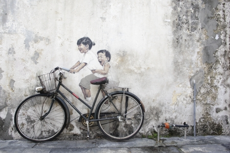 wall mural of a kid riding bicycle