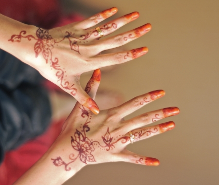 red henna in bride hand photo