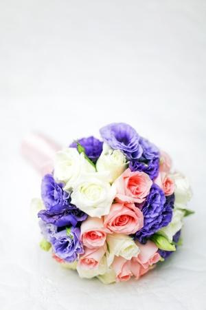 bride flower on white bedsheet