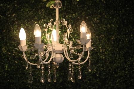 beautiful chandelier light on dark background photo