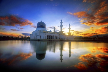 dramatic sunrise at likas mosque