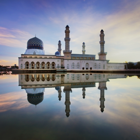 a panoramic view of floating public mosque during awesome sunset  版權商用圖片