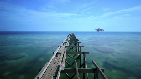 the long exposure during sunlight at mabul island and broken old pier. photo