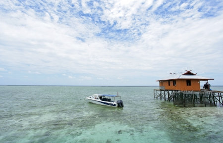 Mabul Island view Turquoise Tropical Paradise Borneo and blue sky photo