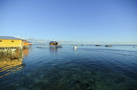 blue sky and green sea view from mabul island lodge