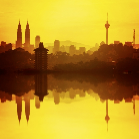 highest skyscraper and the reflection during sunrise in Kuala Lumpur, Malaysia