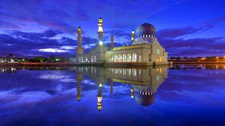 likas: mirror reflection of the majestic mosque in kota kinabalu sabah.