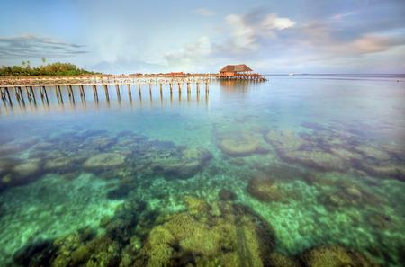Long pier dan beautiful coral at Mabul Island. photo
