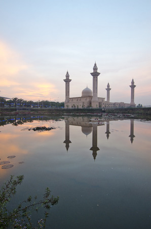 mirror reflection and Sunrise of the Tengku Ampuan Jemaah Mosque photo
