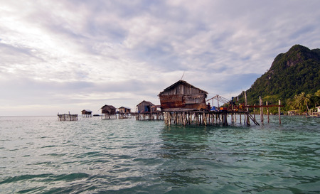 SIBUAN ISLAND, SABAH, MALAYSIA - MARCH 03 : Unidentified Sea Gypsies on March 03, 2014 in Sabah, Malaysia. The Sea Gypsies are sea nomads that move from one place to another.