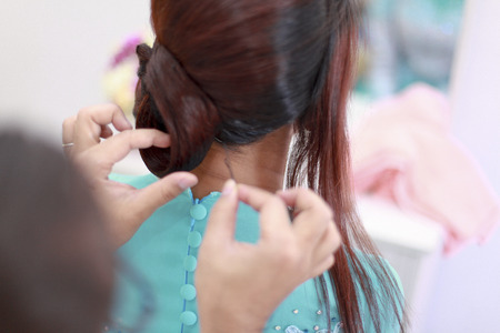 hairstyling: young woman at hairdresser do hairstyling. Stock Photo
