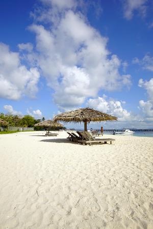 mabul: Landscape photo of beach house in Mabul Island ocean with blue sky