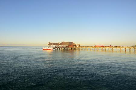 mabul: Long pier dan beautiful coral at Mabul Island. Stock Photo