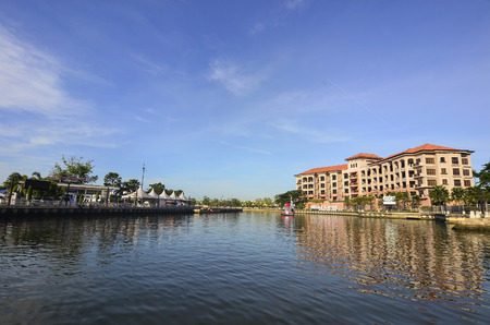 city park boat house: MALACCA, MALAYSIA - NOV 7, 2015 Cruise tour boat sails on the Malacca River in Malacca. Rehabilitation of the Malacca River to develop river tourism started in July 2002. Editorial