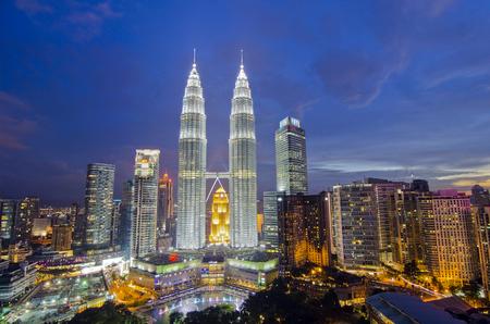 petronas: KUALA LUMPUR, MALAYSIA - MAY 19: Petronas Twin Towers at twilight on May 19, 2012 in Kuala Lumpur. Petronas Twin Towers are twin skyscrapers and were tallest buildings in the world from 1998 to 2004.