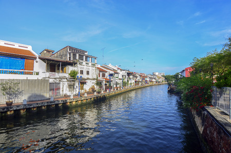 dwell house: Malacca city with house near river under blue sky in Malaysia, Asia. Stock Photo