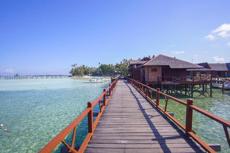 mabul: beautiful floating chalet at mabul island aand blue sky.