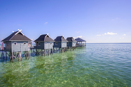 blue sky and green sea view from mabul island. Stock Photo