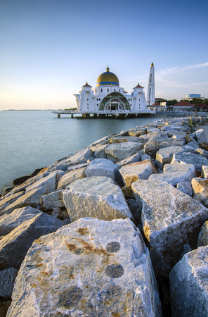 straits: Majestic view of Malacca Straits Mosque during sunset.