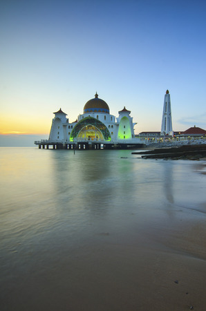 islamic scenery: Majestic view of Malacca Straits Mosque during sunset. Soft focus due to long exposure