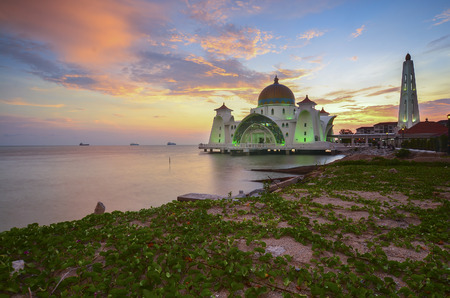 Majestic view of Malacca Straits Mosque during sunset with vibrance colour. Noise slightly appear and soft focus due to long expsoure.