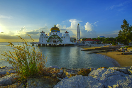 vibrant colour: Majestic view of Malacca Straits Mosque during beautiful sunset. Vibrant colour