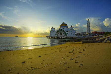 istanbul beach: Majestic view of Malacca Straits Mosque during beautiful sunset. Vibrant colour