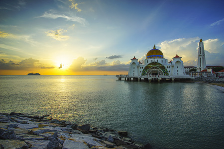 straits: Majestic view of Malacca Straits Mosque during beautiful sunset. Vibrant colour