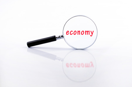 black economy: economy word on Magnifying glass in a metal frame with rubber black handle on white background Stock Photo