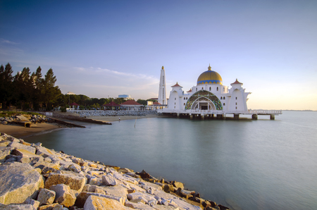 straits: Majestic view of beautiful Malacca Straits Mosque during sunset.