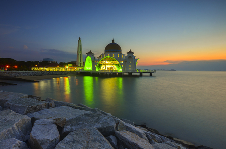 straits: Majestic view of Malacca Straits Mosque during sunset. Soft focus due to long exposure. Virant colours. Stock Photo