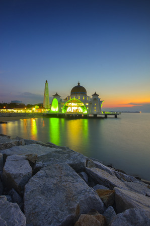 istanbul beach: Majestic view of Malacca Straits Mosque during sunset. Soft focus due to long exposure. Virant colours. Stock Photo
