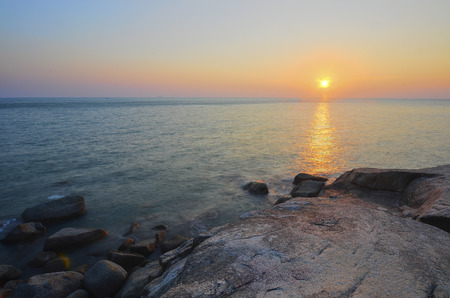 vibrance: sunrise at rocky beach in terengganu, malaysia. image taken with long exposure and vibrance colour Stock Photo