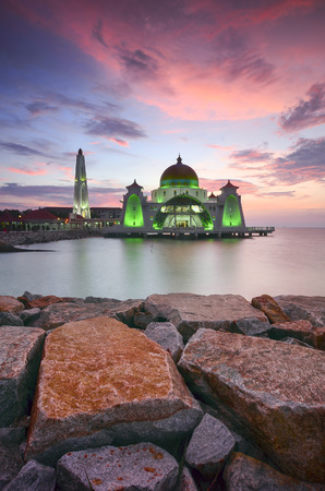 islamic scenery: Majestic view of Malacca Straits Mosque during sunset with vibrance colour. Noise slightly appear and soft focus due to long expsoure.