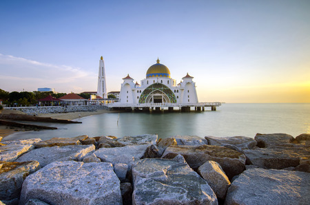 straits: Majestic view of beautiful Malacca Straits Mosque during sunset