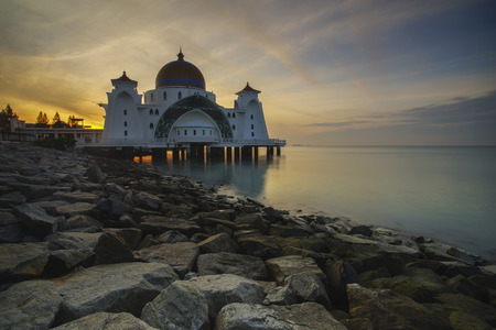 islamic scenery: Beautiful sunrise view of majestic Malacca Straits Mosque during sunrise